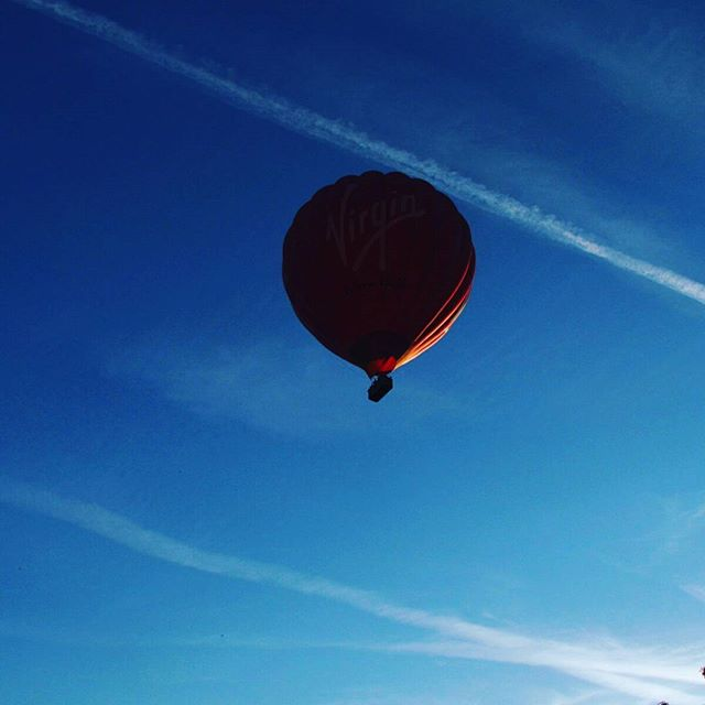 A #virginexperience #hotairballoon came floating overhead...it sent my dog stir crazy, barking and jumping at the #sky 😒😂 #hot #air #balloon #virgin #experience #sky #bluesky #hotday #flyinglow #clearskies #closeup #photooftheday #amateur #photography #photoporn #photoart #fms_anything #canon #powershot #sx30is